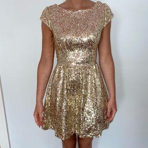 Gold sequin cap sleeve dress